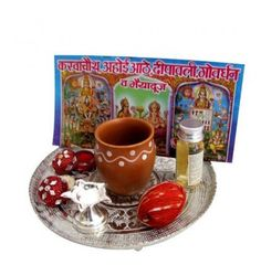 Celebrate the essence of Karwa Chauth occasion with unmatched joy & zeal with this Pooja thali. This stainless steel thali includes Karwa Chauth Vrat Katha. A traditional kalash, a silver diya, roli & chawal, a kalawa roll & gangajal.