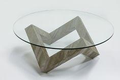Кофейный столик Cube («Куб»)- флагман коллекции 2015 г. Изюминка стола – геометрическое основание, выполнены из каменного шпона Burning Forest. Благодаря стеклянной столешнице видна перламутровая слоистая текстура камня. Размеры: диаметр стекла 1 м., высота столика 45 см.