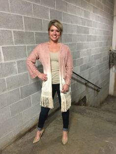 Feisty Fringe. Incredibly soft & easy to layer, we are in love with this awesome fringe cardigan. It adds so much sass, it's a breeze to pair with tops, dresses or tunics!