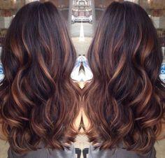 Dark brown hair with caramel lowlights