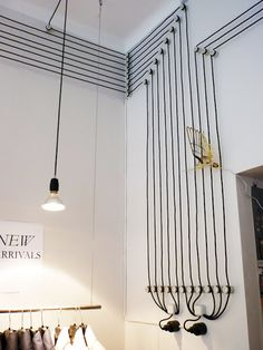 gorgeous way to deal with cords - love the idea of externally wiring a house instead of hiding them between boardings.