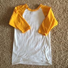 Yellow Baseball tee Comfy yellow baseball tee. It's. Youth Medium but it's fits me and I'm an adult small/medium. It does have minor bleach stains on right sleeve (pictured) but it's hardly visible. Sleeves are quarter sleeve. Russell Athletic Tops Tees - Short Sleeve