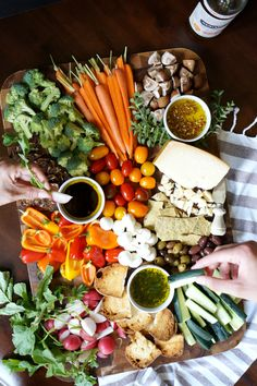 Upgrade your veggie tray by turning it into Pinzimonio! This Italian-style veggie platter features olive oil for dipping, fresh cheese, and toasted bread. Veggie Platters, Veggie Tray, Cheese Platters, Vegetable Trays, Veggie Appetizers, Appetizers For Party, Christmas Appetizers, Christmas Snacks, Healthy Snacks