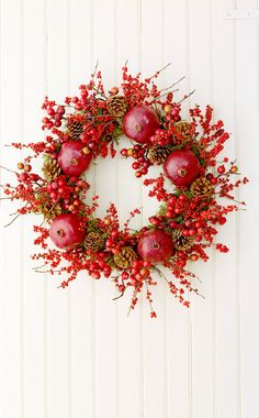 Add holiday color to your home with the vibrant hues of winterberry and pomegranates. #falldecor #fallideas #wreathideas #fallwreath #wreath #bhg