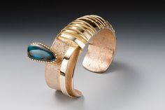 Cuff | Michael Roanhorse (Navajo). 18k gold and Turquoise