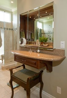Webb - The Webb family wanted an elegant update to their master bath suite. We accommodated their needs by adding a large shower and dual bath sinks accented by a seated makeup area. They now have the perfect place to relax and unwind after a long day.