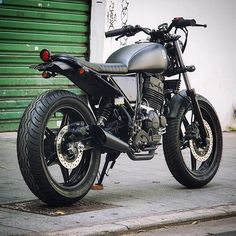 Honda 'Cafuza' by @benditamacchina of Brazil. The perfect stealth weapon for the streets of São Paulo. #benditamacchina #honda #tracker #bikeexif
