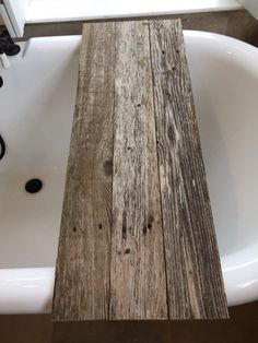 Reclaimed Wood Tub Caddy - Rustic Bathtub Tray- Barn wood Bathtub Caddy -Tub Shelf -Bathroom Decor -Bath - Spa -Home Design -Wedding Gift.  For Sale is a ~ is a Reclaimed Barnwood Wood Bathtub Caddy- Rustic Tub Tray - Tub Caddy- Bathtub Tray -Spa Tray, Custom designed by JBailie Woodworks for a Perfect Luxurious Spa feel.  Rustic Wood Bathtub Tray Caddy can be used for various purposes. Nothing is more enjoyable than a long soothing bath accompanied by items that we love. You can also read a…