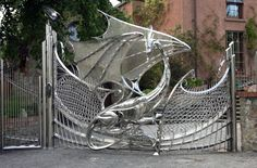 "Truly beautiful piece of art, and it's functional!! It will keep uninvited ""guests"" off your property. :-)     chainmaille + dragon sculpture = freaking awesome driveway gate"