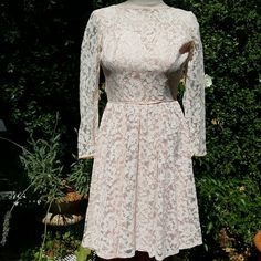 """Vintage Pale Pink Lace Ling Sleeve Dress Preloved Lace Dress, with a rounded lower back.  Dress is fully lined in pale pink satin, sleeves are sheer.  Metal zipper. The sheer interfacing is pulling apart from satin trim, (will send detailed pictures upon request) otherwise in excellent vintage condition.  Looks to be made in the 50's possibly early 60's.  No refunds or exchanges.  All sales are final.  No pp.  Measurements: Bust under arm to understand arm 32"""" Waist24"""" Dresses Long Sleeve"""