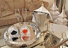 Crystal Champagne glasses and red and black caviar served on a silver platter in the La Residence 5 Star Luxury Hotel Suites in Mykonos island in Greece.