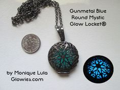 Here is one of my classic Glow Lockets® in gunmetal finish, with blue glow! This is a really gorgeous locket, also great for guys. The dark metal looks so magical with the blue glow shining through! T