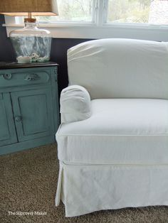 Casual and durable, this washed white denim slipcover is perfect for lakeside living.