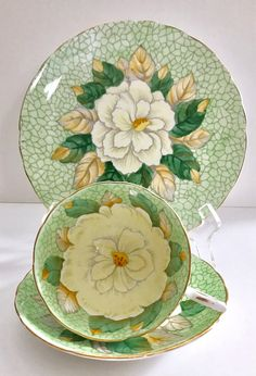 Beautiful vintage china tea cup trio, made by Tuscan China in England. This is a beautiful trio with a white gardenia on the cup, saucer and 8 Plate, the pattern is called golden rose. It is in good condition, no chips, cracks or crazing. Please Note: The items I sell are not new,
