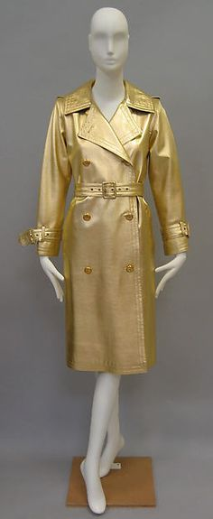 Yves Saint Laurent, French, 1980 Leather, Metal Trench coat Leather that had colorful or metallic finishes became popular in the 80s. This could be in everyday pieces like tops or skirts, but also evening dresses. Here the metallic finish is featured on a leather trench coat, giving it a glamorous look.