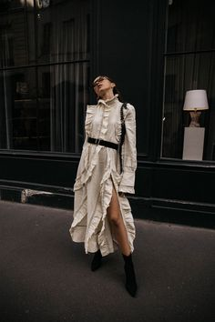 How to wear Sonia Rykiel ruffled linen dress with black sock boots trend in paris editorial outfit ideas