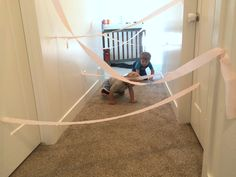 """I was watching one of our neighbor's kids the other day and I needed to put mybaby down for a nap.My son and his friend had been happily playing outside, but we live by a busy street so I had to coax them to come inside for a bit. This was a hit with them … Continue reading """"Toddler Activity – Dodge The Lasers"""""""