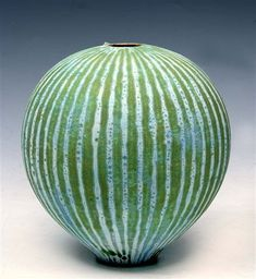 Vessel by British ceramic artist Peter Beard (b.1951). A thrown ovoid green & white vessel with inverted rim, double seals to the base, 8 in high. via Mallams Auctioneers