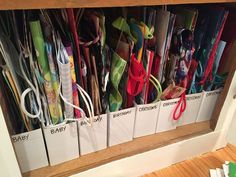 Gift bag storage using IKEA magazine holders. - Ikea DIY - The best IKEA hacks all in one place