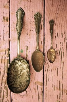 Silver spoons on a pink wall. LOVE.