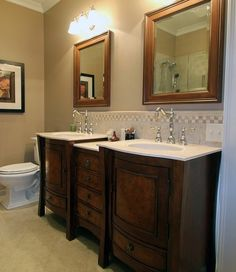 love turning an old dresser into a vanity w/sink(s) would have chose different mirrors but love this look!