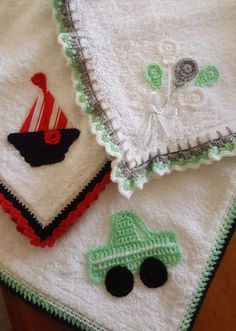 Crochet edging and applique motifs on baby nappies.