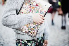 metallic clutch bag plastered with stickers