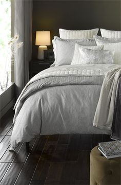 subtle grey and white print duvet. in the photo it looks like it is reversible with a simpler stripe pattern on the back side, which we would prefer over the peacock, but the description says nothing about it