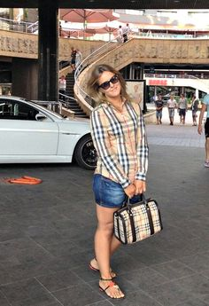 1- Valentino  Glasses / Sunglasses / 2- Burberry  Shirt / Blouses / 3- Zara  Shorts / 4- Carlo Pazolini  Gladiators / 5- Burberry  Bags