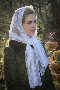 Limited quantity available.  This is SOFT! This soft and lovely white Chantilly lace chapel scarf is trimmed at the front with a vintage-look floral lace, and features scalloped lace ends. It may also be used as a shawl, scarf, or wrap before or after Mass. It measures about 48 x 20 inches .  Also in black here:  https://www.etsy.com/listing/489608415/evintage-veils-vintage-look-black-chapel?ref=shop_home_active_11   Questions? Please convo us; we are happy to re...