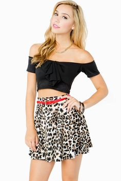A short skater skirt with an extra dose of wild! Allover leopard print. Belt loops at the waist with a contrast skinny belt. Pair with a crop top and heels for a fierce look.