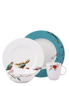 I love these plates. Very much my style - the colors, the birds, the whimsy.
