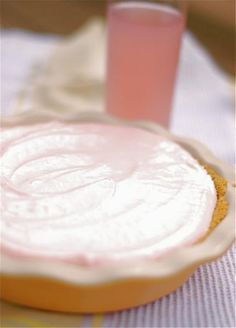 This pink lemonade pie recipe - cream cheese, sweetened condensed milk, pink lemonade concentrate (which adds a nice little kick), frozen whipped topping, and a graham cracker crust. Whip the cream cheese and condensed milk together in a large bowl, then stir in the concentrate and whipped topping. Pour the mixture into the prepared crust and let it freeze for about 4 hours.