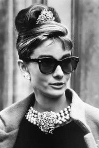 a91e9d51937d4f People often mistakenly think Audrey Hepburn s iconic sunglasses in  Breakfast at Tiffany s are Ray-Bans.Audrey Hepburn as Holly Golightly  eating croissant ...