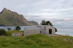 """This project for a summer retreat is an addition to, and rehabilitation of an old """"Nordlandshus"""" (traditional northern Norwegian house) on a remote site in the coastal island area of Lofoten. Nature Architecture, Residential Architecture, Lofoten, Norway House, Zinc Roof, Metal Roof, Norwegian House, Timber Structure, Home Additions"""