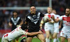 Jonny Lomax of England tackles Canberra Raiders Jordan Rapana of New Zealand Kiwis during the Four Nations match between the England and New Zealand Kiwis at the John Smith's Stadium on October 29, 2016 in Huddersfield, United Kingdom.
