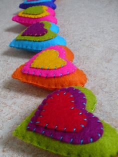 Colorful felt hearts garland XL made to order by HetBovenhuis Felt Crafts Diy, Felted Wool Crafts, Felt Embroidery, Felt Applique, Felt Pillow, Heart Garland, Felt Birds, Felt Decorations, Felt Christmas Ornaments