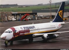 Ryanair Boeing 737-204.  Glasgow - Prestwick (PIK) - 1998.  EI-CJD with a Scottish flavour. A scarf and a cheesey smile!