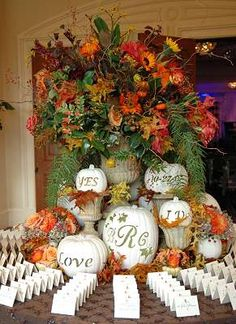the flowers are a little over the top but the white carved pumpkins are perfect :)
