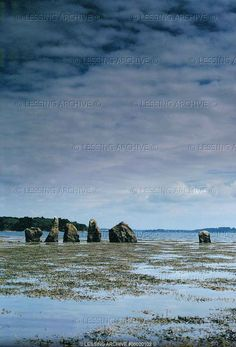A double cromlech (figure eight) of menhirs put up by early populations between 5000 and 2000 BCE on the Island of Er Lannic, Gulf of Morbihan, Brittany.