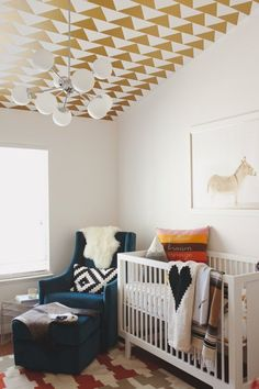 This space is for a nursery, but how amazing is that ceiling to create height in a small room? Beautiful.