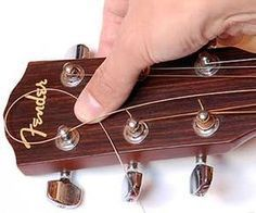How to string a guitar - a step-by-step guide with photos