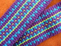 ASpinnerWeaver: In Celebration of Plain Weave  (try this one and use varigated instead of the purple, maybe?  With a single contrasting color for the rest?)