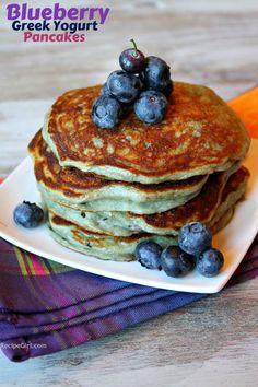 Greek yogurt pancakes  a container of Greek yogurt- any kind,  Add an egg.  In a separate bowl, mix 1/2 cup flour + 1 teaspoon baking soda.  Stir the yogurt/egg mixture into the dry ingredients.  Add a few fresh blueberries on top.  only 91 calories and 2 WW Points!