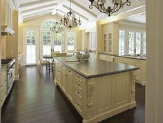 Lovely french inspired kitchen. Would love to see how it looks with dark base cabinets.