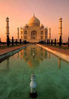 Taj Mahal in Agra, India. Considered a jewel of Muslim art in India, and honored as a UNESCO World Heritage Site in 1983, this mausoleum is perhaps the most beautiful tribute to a real life love story that the world has ever seen.