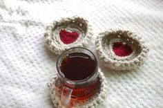 Set your drinks down on these chunky knit, heart centered crochet coasters! Each order comes with 4 coasters. Each coaster is approximately 5 inches wide. Measure on the backside. Although I created this as a pattern, these are handmade items so slight modifications in each product are possible. Yarn is technically machine washable but due to the gentle nature of these coasters I would hand wash and lay flat to dry.