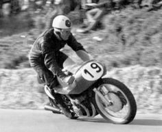 Geoff Duke showing off his trials riding skills on the Gilera 4