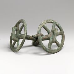 early 1st millennium B.C. Horse bit with wheels on either end.