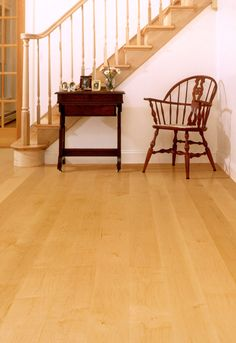 "White maple wide plank flooring: 6"" to 10"" widths and 7' to 8' lengths. Finished in amber stain and topped with clear sealant."
